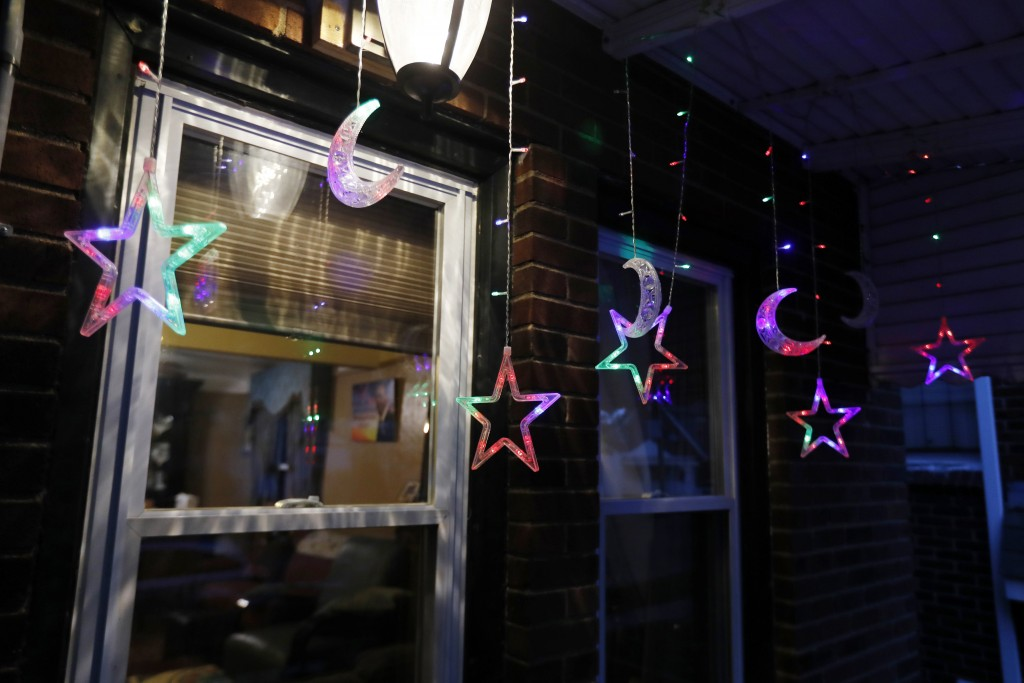 In this Tuesday, April 28, 2020 photo, Ramadan lights are displayed on a house in Dearborn, Mich. The Muslim community in Dearborn is starting a new t...