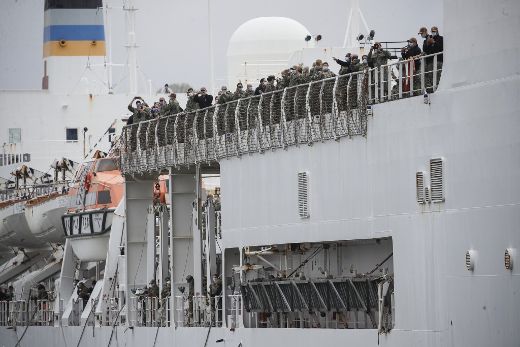 USNS Naval Hospital Ship Comfort personnel line the decks as they depart via the Hudson River, Thursday, April 30, 2020, in the Manhattan borough of N...