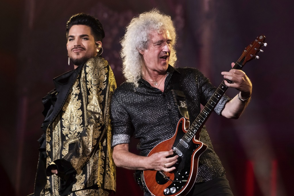 FILE - In this Sept. 28, 2019 file photo, Adam Lambert, left, and Brian May, of Queen, perform at the Global Citizen Festival in New York. Lambert and...