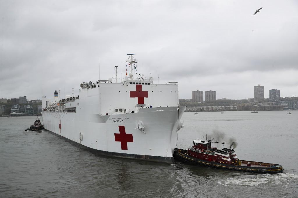 The USNS Naval Hospital Ship Comfort departs via the Hudson River, Thursday, April 30, 2020, in the Manhattan borough of New York. (AP Photo/John Minc...