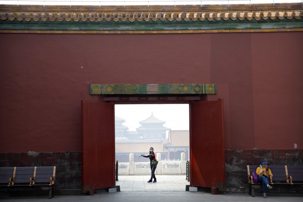 Visitor wearing face mask walks through Forbidden City in Beijing May 1, 2020.