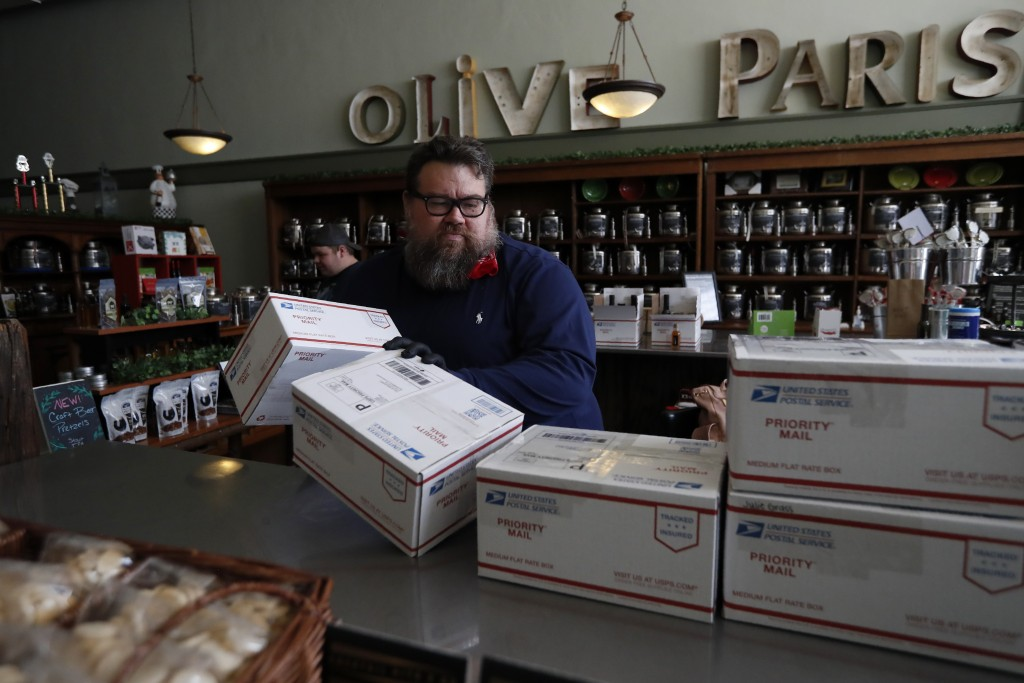 Daryl Felsberg, who along with his wife Heather, own Olive Paris, off the town square prepares orders for shipping at his store in Paris, Texas, Wedne...