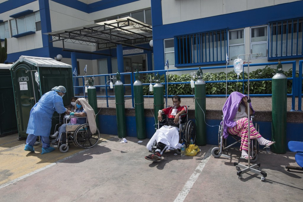 People infected with COVID-19 disease wait for an available bed, outside a public hospital in Lima, Peru, Thursday, April 30, 2020. (AP Photo/Rodrigo ...