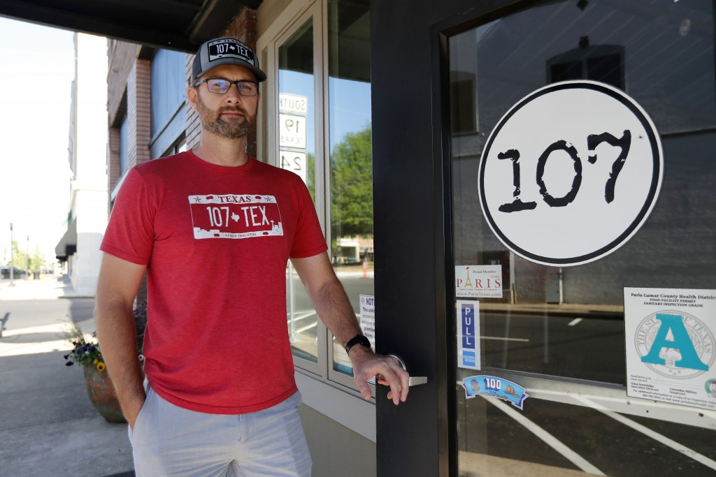 In this Wednesday, April 29, 2020, photo John Bratcher poses for a photo outside of his restaurant named, 107 in Paris, Texas. Bratcher, whose restaur...