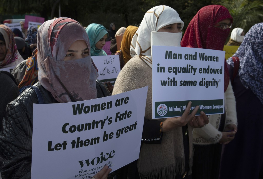 FILE - In this March 8, 2020 file photo Activists of the Pakistani religious party Minhaj-ul-Quran observe International Women's Day at a rally in Isl...