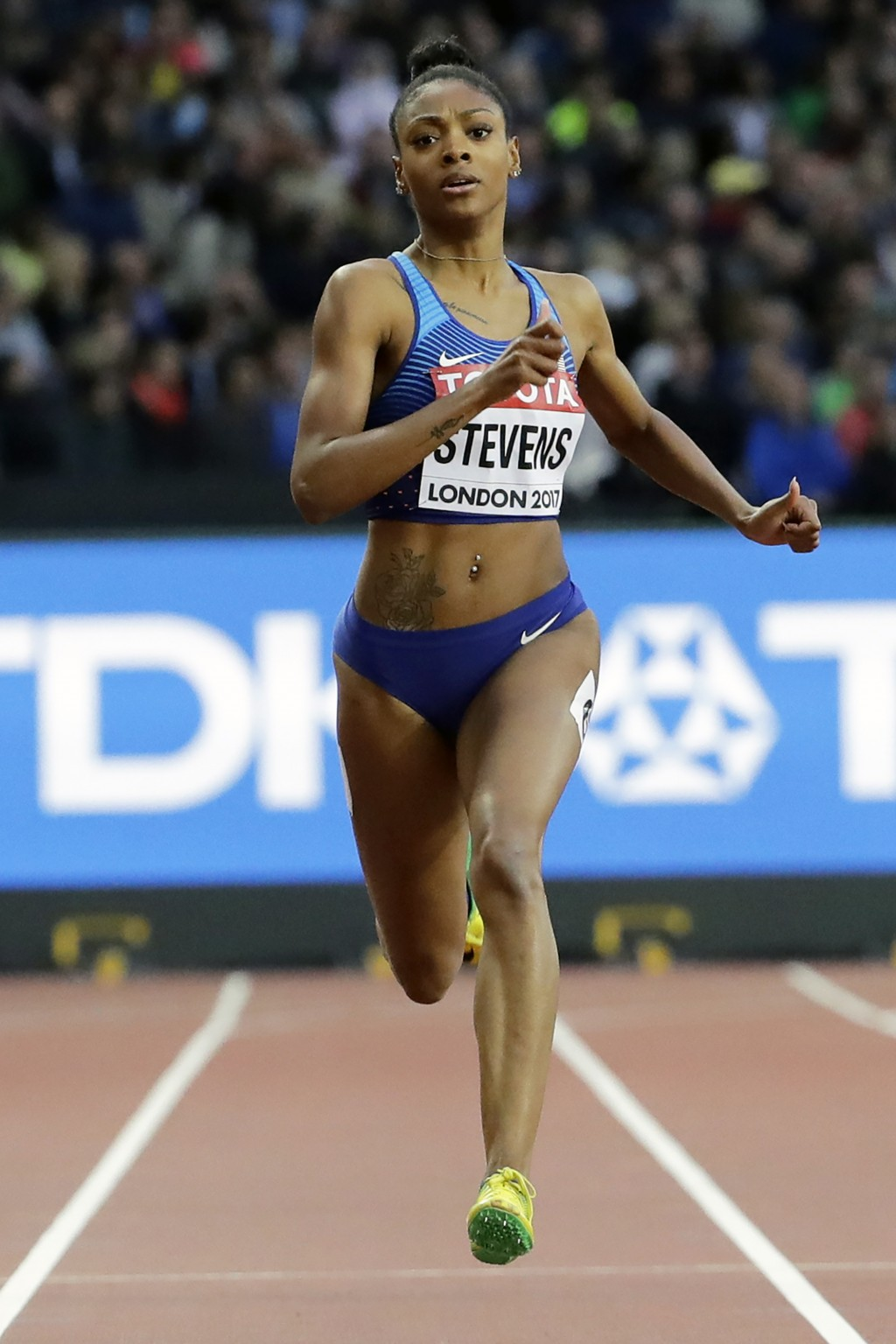 FILE - In this Aug. 8, 2017, file photo, United States' Deajah Stevens races in a women's 200m first round heat during the World Athletics Championshi...