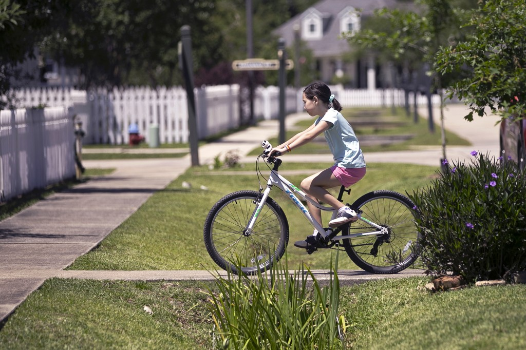 Juliet Daly, 12, rides her bike outside her home in Covington, La., Thursday, April 30, 2020. A team of pediatric cardiology specialists found that Ju...