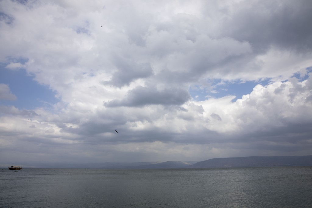 In this Saturday, April 25, 2020 photo, birds fly while an empty tourist ship is anchored in the Sea of Galilee, locally known as Lake Kinneret. After...