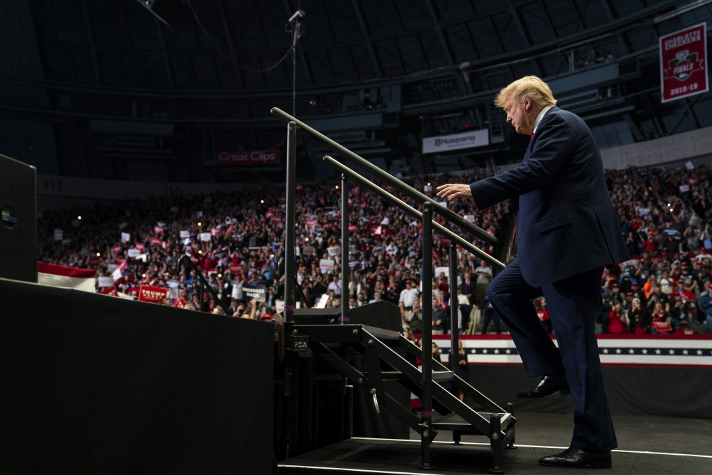 FILE - In this March 2, 2020, file photo President Donald Trump arrives to speak at a campaign rally at Bojangles Coliseum in Charlotte, N.C. Six mont...