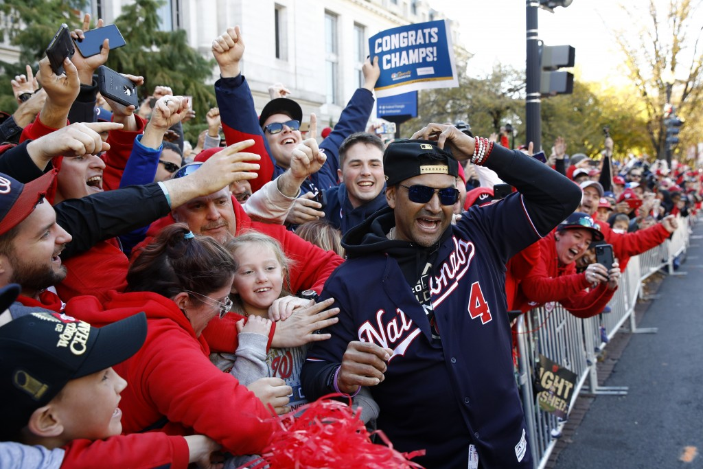 FILE - In this Nov. 2, 2019, file photo, Washington Nationals manager Dave Martinez celebrates with fans during a parade to celebrate the team's World...