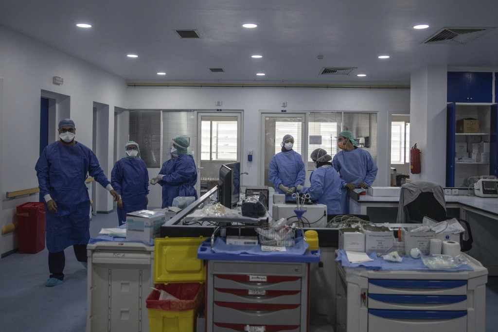 In this photo taken on Wednesday, April 15, 2020, healthcare workers stand inside one of the COVID-19 intensive care units (ICU) of the Moulay Abdella...