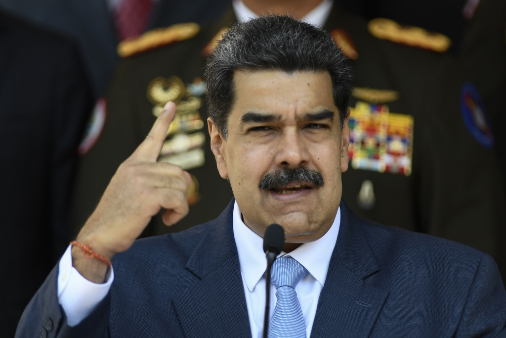 FILE - In this March 12, 2020 file photo, Venezuelan President Nicolas Maduro givesa press conference at the Miraflores presidential palace in Caracas...