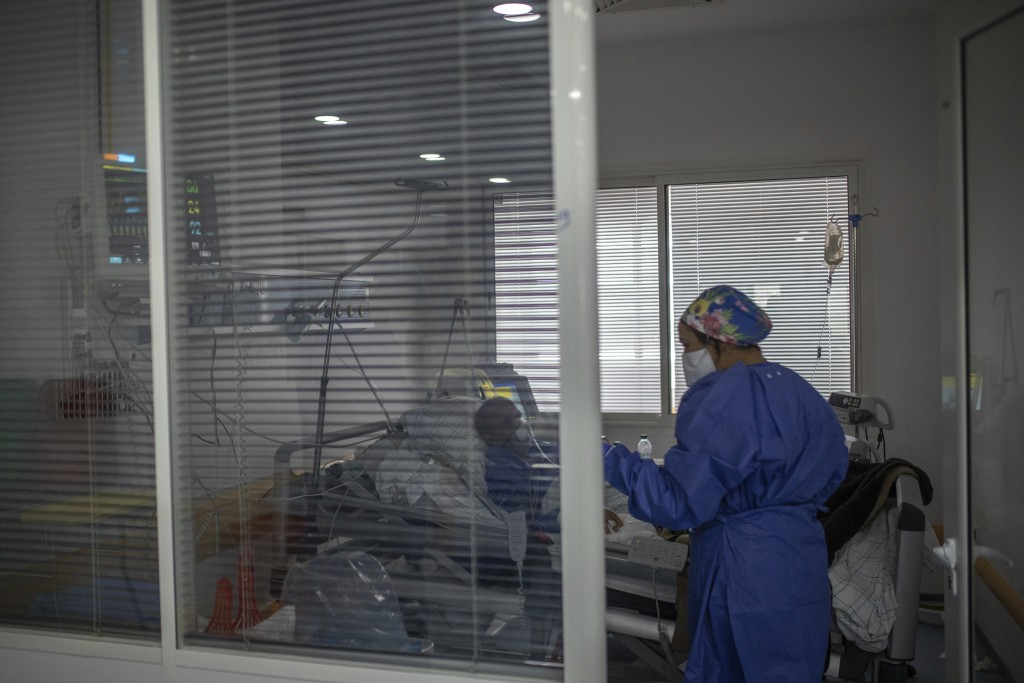 In this photo taken on Wednesday, April 15, 2020, a healthcare worker assists a COVID-19 patient at one of the intensive care units (ICU) of the Moula...