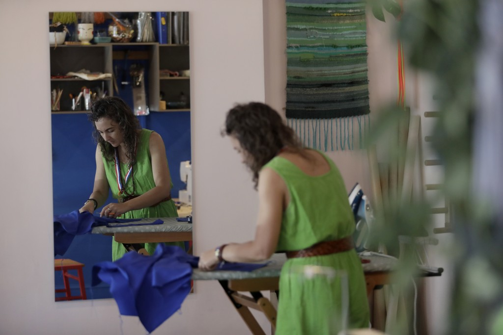 Textile artist Brooke Dennis, who is originally from New Zealand, makes scrubs for NHS (National Health Service) staff to wear during the coronavirus ...