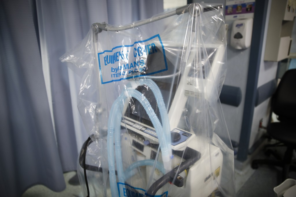 FILE - In this April 20, 2020, file photo a ventilator waits to be used for a COVID-19 patient going into cardiac arrest at St. Joseph's Hospital in Y...