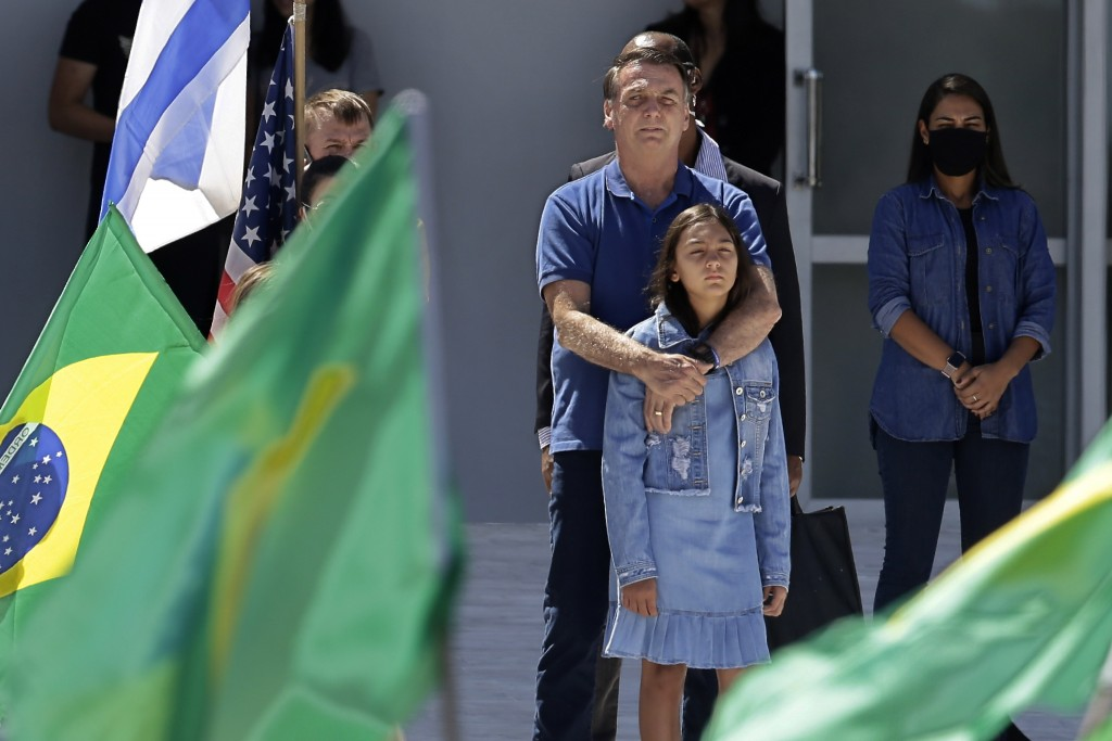 Brazil's President Jair Bolsonaro embraces his daughter during a protest against his former Minister of Justice Sergio Moro and the Supreme Court, in ...