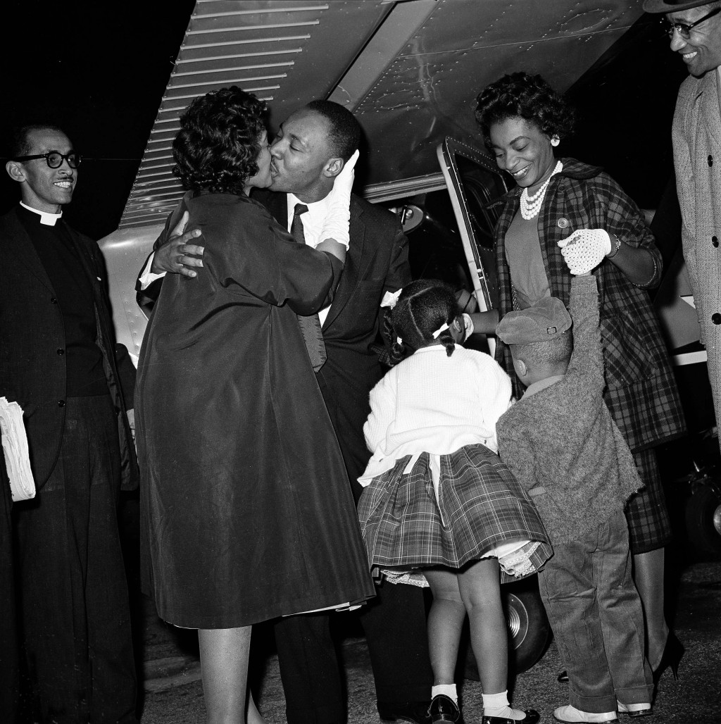 FILE - In this Oct. 27, 1960 file photo, Martin Luther King Jr. is given a kiss by his wife Coretta as he is welcomed back from Georgia's Reidsville S...