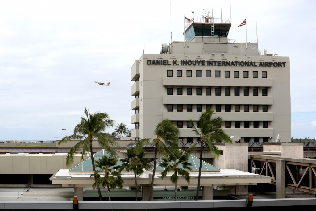 In this April 21, 2020, photo, a plane takes off over the international airport in Honolulu. Hawaii has some of the lowest coronavirus infection and m...