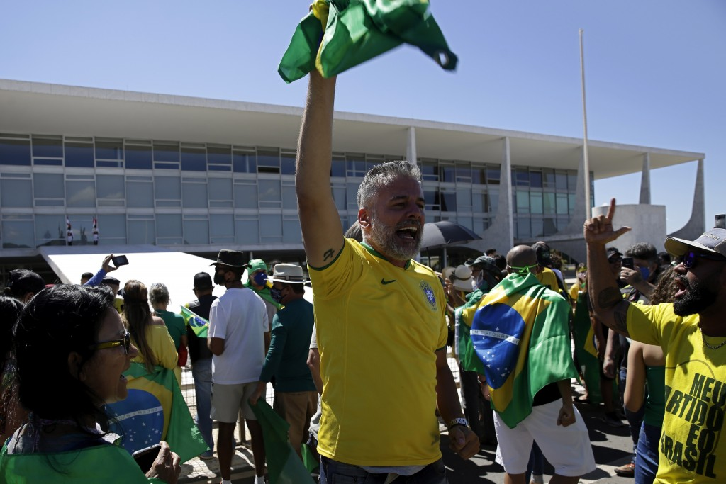 Supporters of Brazil's President Jair Bolsonaro shout slogans during a protest against his former Minister of Justice Sergio Moro and the Supreme Cour...