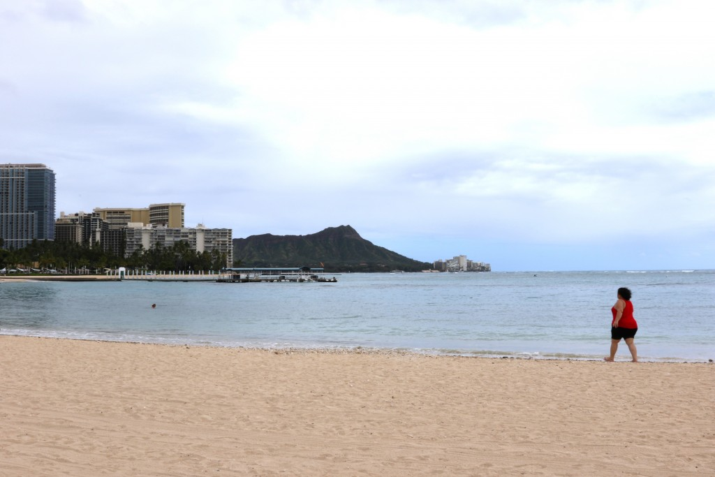 In this April 21, 2020, photo, a woman walks on Waikiki Beach in Honolulu. Hawaii has some of the lowest coronavirus infection and mortality rates in ...