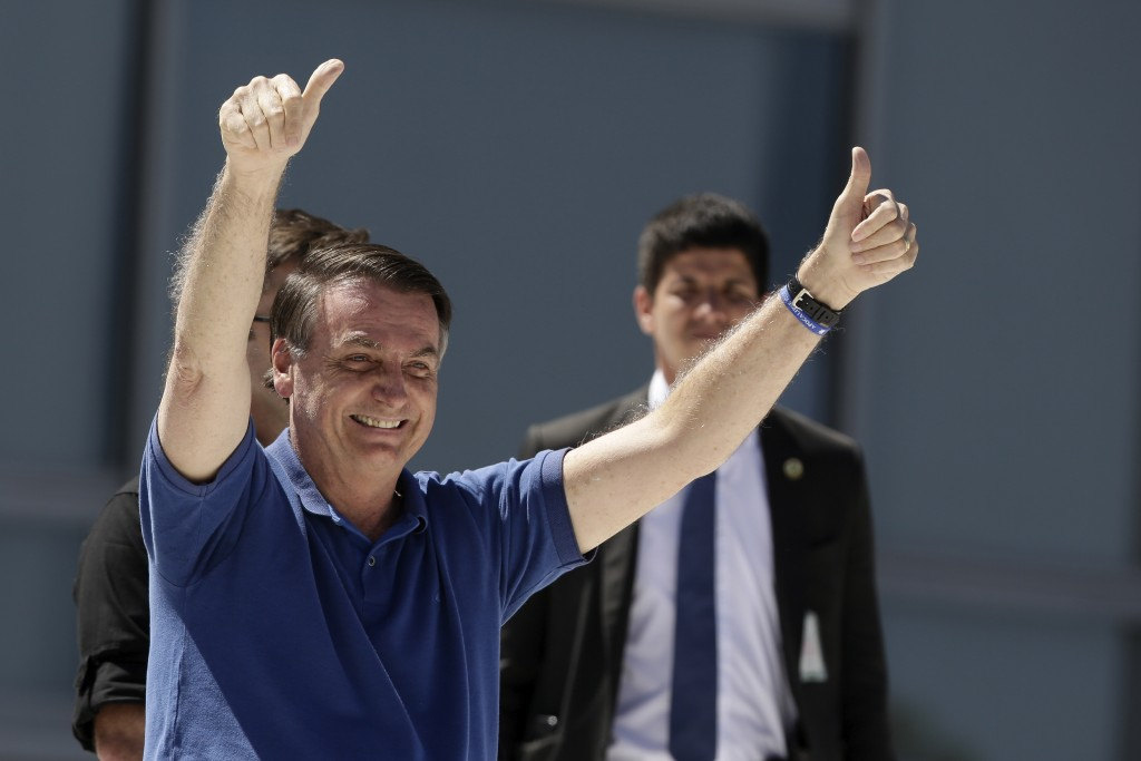 Brazil's President Jair Bolsonaro signals thumbs up to his supporters during a protest against his former Minister of Justice Sergio Moro and the Supr...