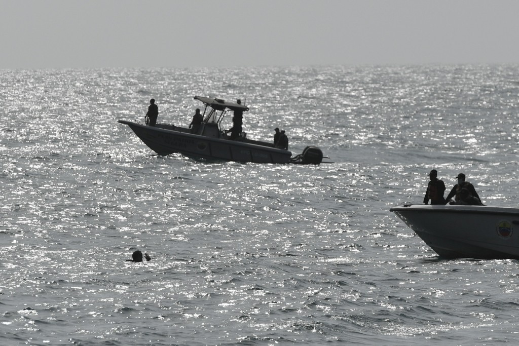Security forces investigate near the shore in the port city of La Guaira, Venezuela, Sunday, May 3, 2020. Interior Minister Nestor Reverol said on sta...