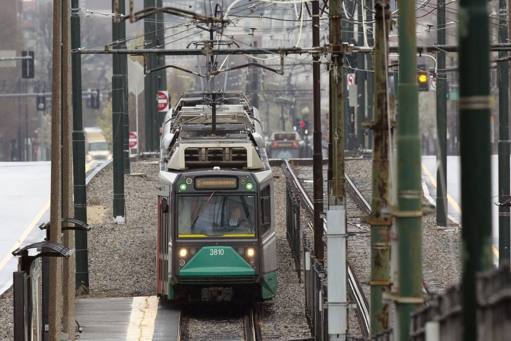FILE - In this April 24, 2020, file photo, a Massachusetts Bay Transportation Authority Green Line trolley runs along Commonwealth Ave., in Boston. Pu...