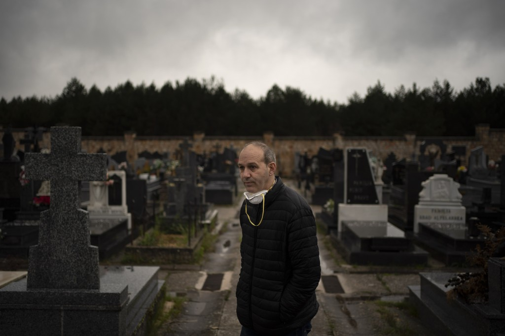 In this April 28, 2020 photo, Mayor Alberto Abad stands in the cemetery in Duruelo de la Sierra, Spain, in the province of Soria. Many in Spain's smal...