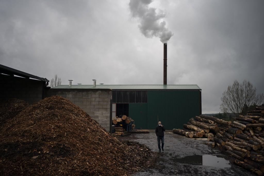 In this April 28, 2020 photo, mayor Alberto Abad walks outside a wooden pallet factory in Duruelo de la Sierra, Spain, in the province of Soria. Many ...