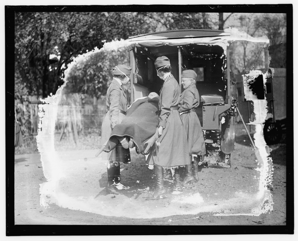 This Library of Congress photo shows a demonstration at the Red Cross Emergency Ambulance Station in Washington, D.C., during the influenza pandemic o...