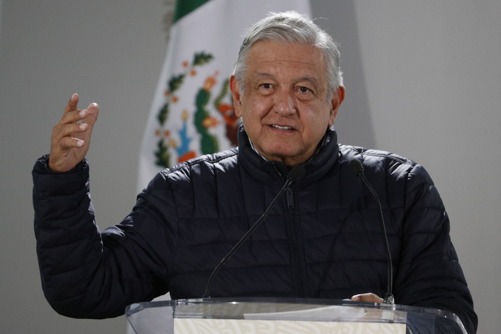 FILE - In this April 3, 2020 file photo, Mexican President Andres Manuel Lopez Obrador speaks after visiting facilities at a Mexican Social Security I...