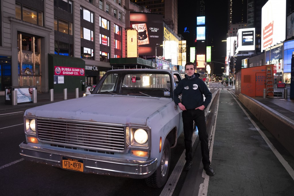 "In this April 29, 2020 photo, Mike Hodurski poses with his 1977 Chevy pickup in New York's Times Square during the coronavirus pandemic. ""It's a lot o..."