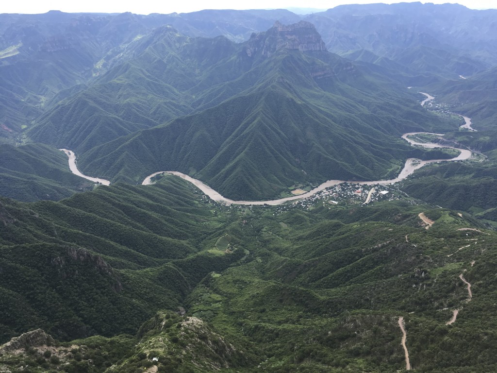 In this Aug. 21, 2019 photo, the Urique river meanders through the Barranca de Urqiue in the Tarahumara mountains in Chihuahua state, Mexico. In the r...