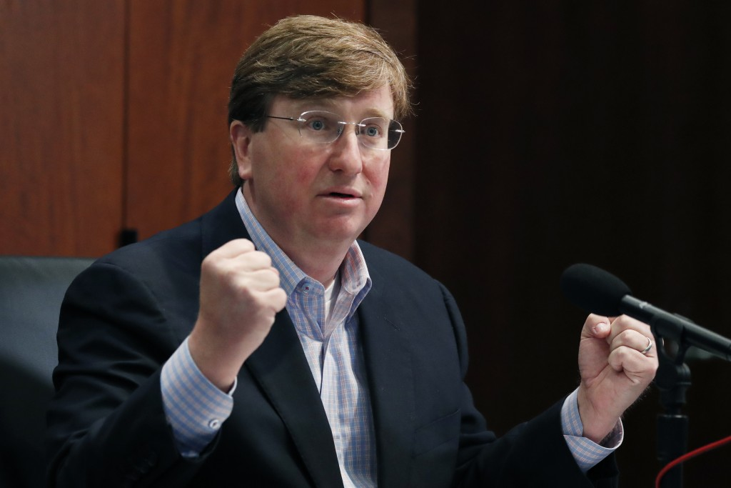 Republican Gov. Tate Reeves gestures Monday, May 4, 2020, in Jackson, Miss., as he wonders how needy state residents are being helped when lawmakers p...
