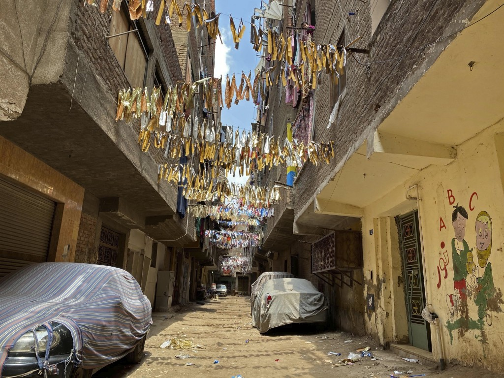 This April 17, 2020 photo, shows the street where 73-year-old Ghaliya Abdel-Wahab died from COVID-19 on April 6, 2020, on one of two streets on comple...