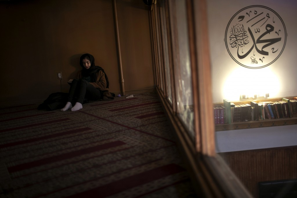 Dania Darwish, 27, director of the Asiyah Women's Center and a volunteer with Muslims Giving Back reads her Quran between volunteering work, at the Mu...