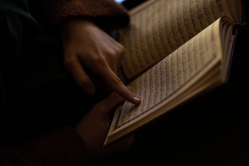Dania Darwish, 27, director of the Asiyah Women's Center and a volunteer with Muslims Giving Back reads her Quran between volunteering at the Muslim C...
