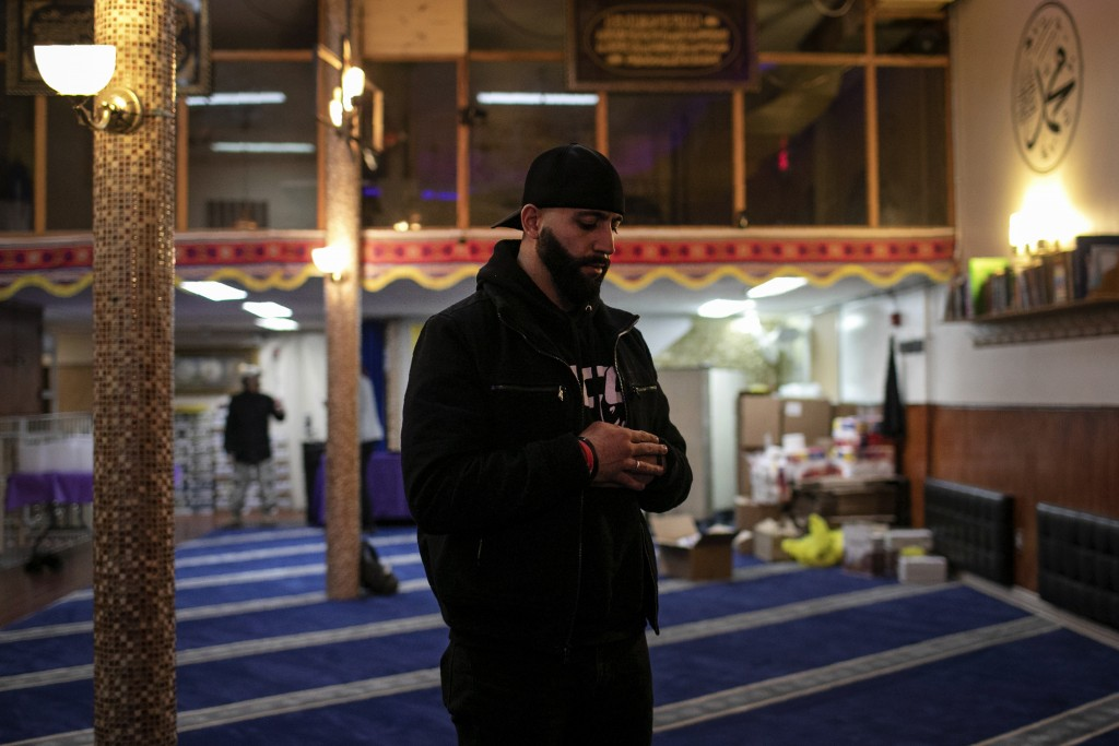 Mohammed Widdi, 31, coordinator of Muslims Giving Back, prays at the Muslim Community Center between volunteering on Monday, April 27, 2020, in the Br...