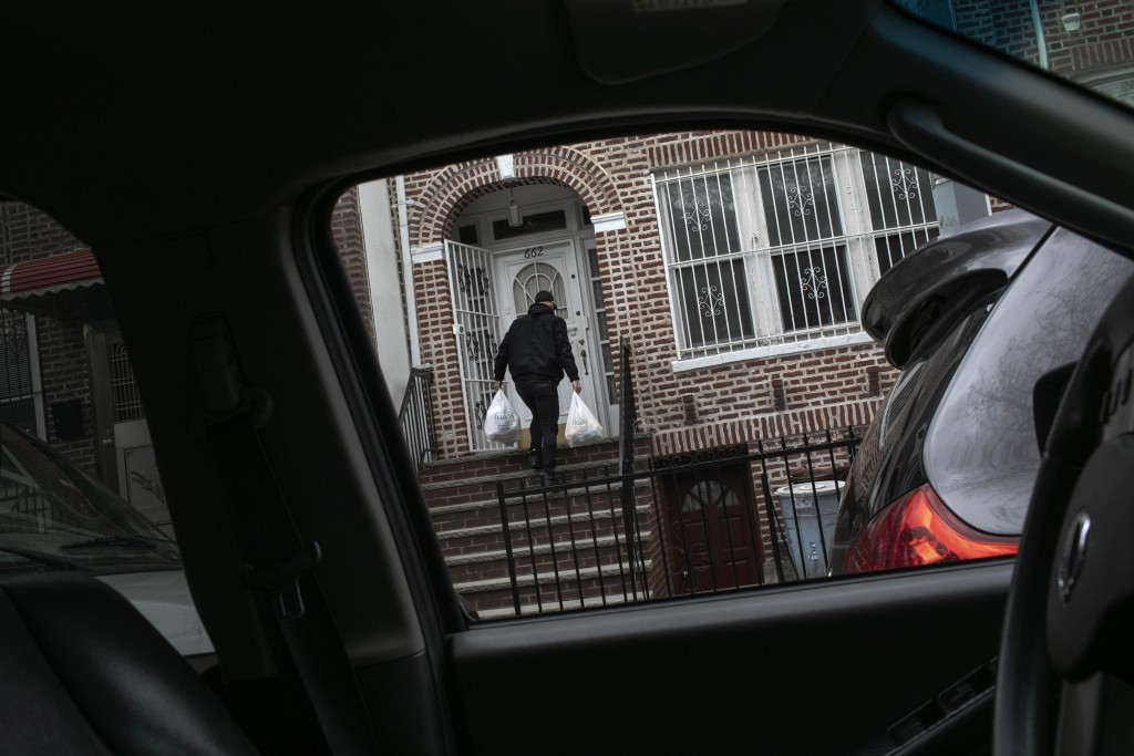 Mohammed Widdi, 31, coordinator of Muslims Giving Back, drops off groceries for a family affected by COVID-19 in the Bay Ridge neighborhood of Brookly...