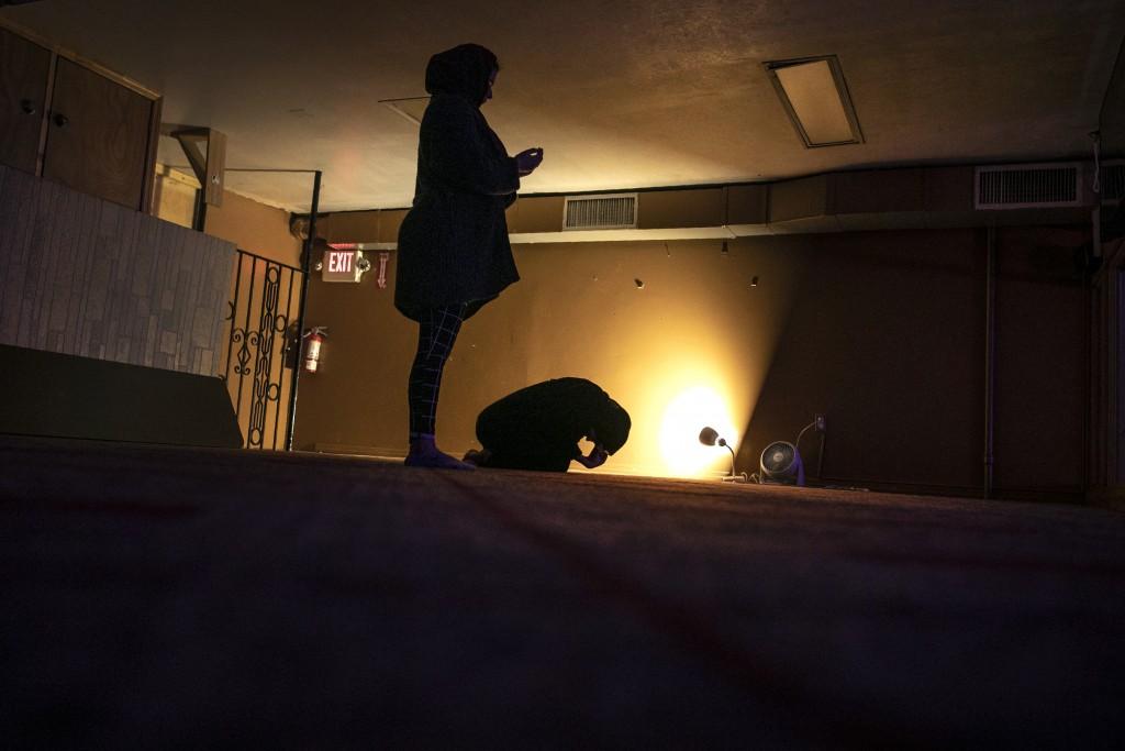 Dania Darwish, 27, right, and Mena Widdi, 26, participate in nighttime prayers in the Muslim Community Center in the Bay Ridge neighborhood of Brookly...