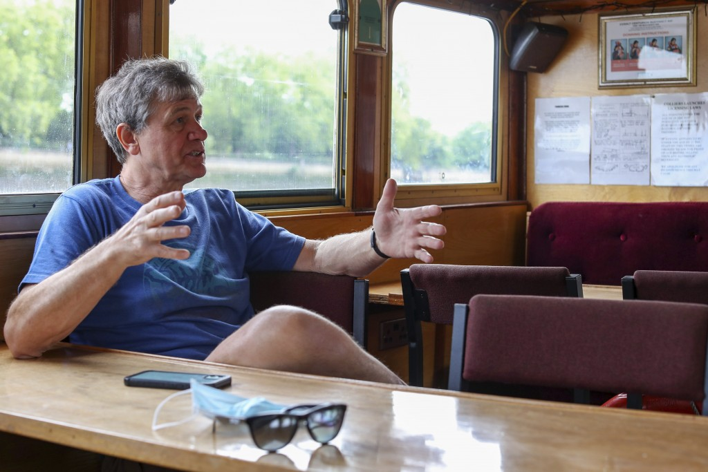 Danny Collier gestures as he sits in his boat, the Princess Freda on the river Thames in London,  Friday, May 8, 2020. Danny and his brother  John Col...