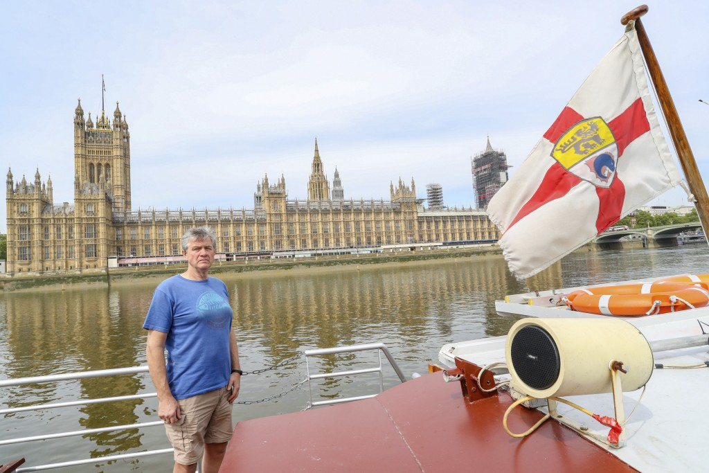 Danny Collier stands on deck aboard his boat, the Princess Freda on the river Thames in front of the Houses of Parliament in London, Friday, May 8, 20...
