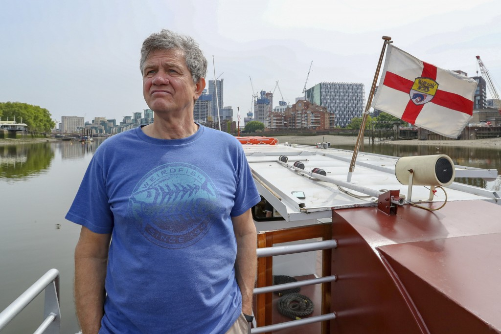 Danny Collier stands on deck aboard his boat, the Princess Freda on the river Thames in London,  Friday, May 8, 2020. Danny and his brother  John Coll...