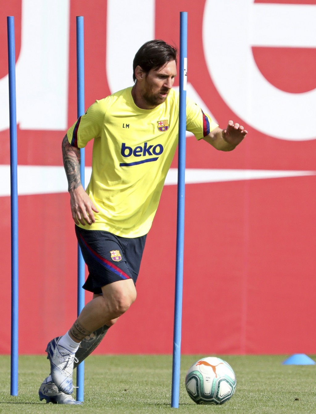 In this photo provided by FC Barcelona, Barcelona's Lionel Messi trains in Barcelona, Spain, on Friday May 8, 2020. Soccer players in Spain returned t...