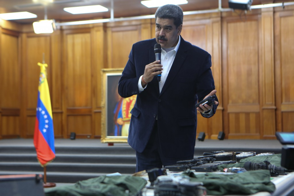 This photo released by the Venezuelan Miraflores presidential press office shows President Nicolas Maduro speaking over military equipment that he say...