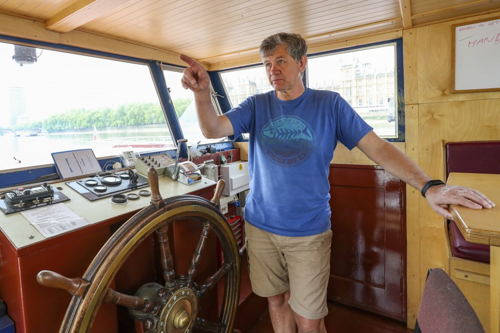 Danny Collier gestures as he speaks aboard his boat, the Princess Freda on the river Thames in London,  Friday, May 8, 2020. Danny and his brother  Jo...