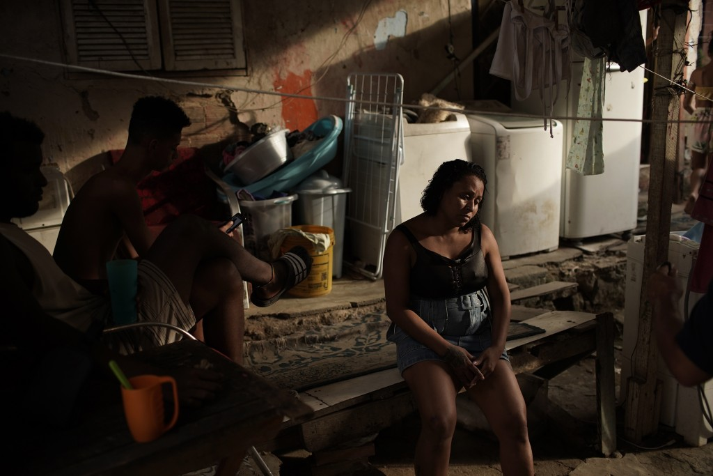 In this Wednesday, April 15, 2020 photo, manicurist and mother of seven children Leticia Machado, who is jobless due to the novel coranvirus pandemic,...