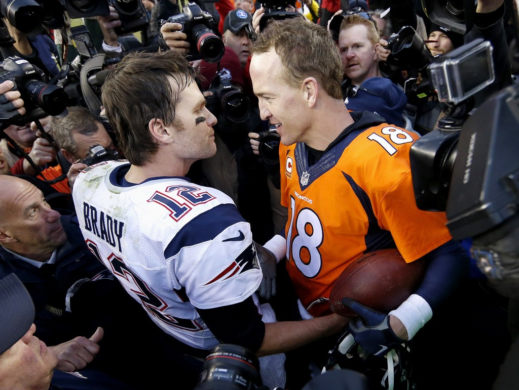 FILE - In this Jan. 24, 2016, file photo, New England Patriots quarterback Tom Brady, left, and Denver Broncos quarterback Peyton Manning speak to one...