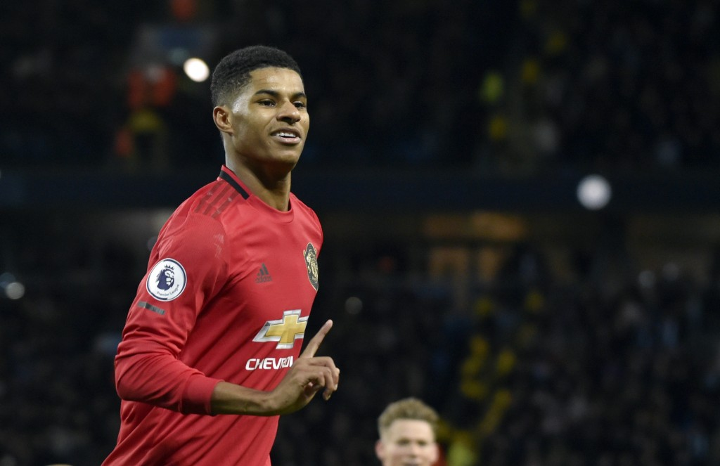 FILE - In this Saturday, Dec. 7, 2019 file photo, Manchester United's Marcus Rashford during their English Premier League soccer match against Manches...