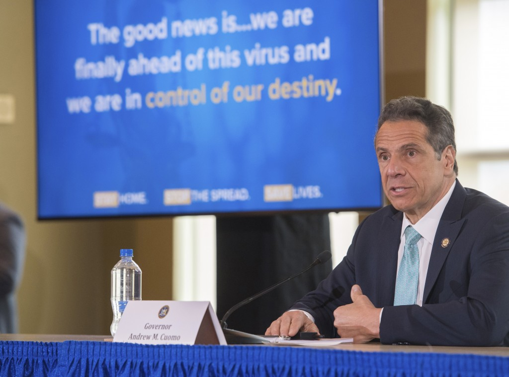 In this photo provided by the Office of Governor Andrew M. Cuomo, Gov. Cuomo briefs the media during a coronavirus news conference at Marist College, ...